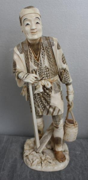10: Signed Asian Ivory of Man Carrying Basket.