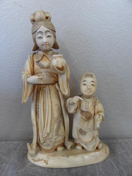 13: Asian Ivory of a Woman and Child.