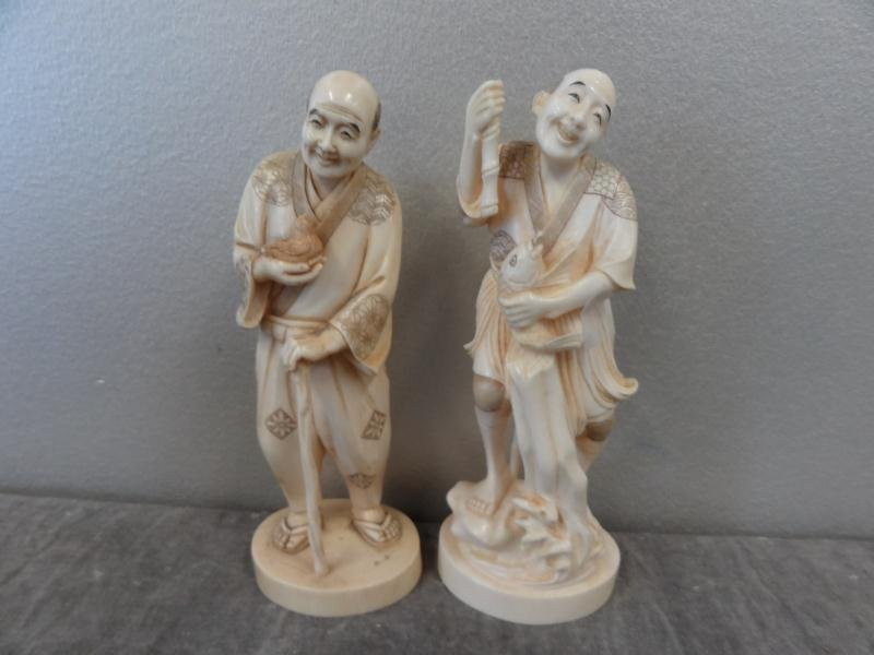 16: 2 Signed Asian Ivories.