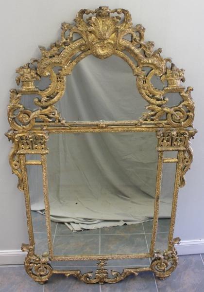 125: 18th Century Giltwood Regence Mirror.