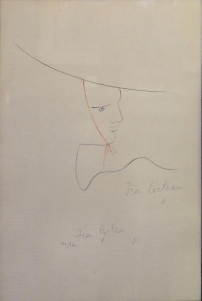 COCTEAU, Jean. Lithograph of a Face with Hat.