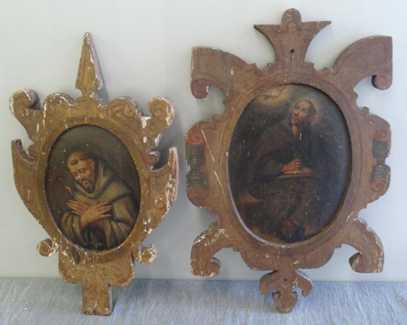 Two Antique Oils of Saints on Carved Wood Panels.