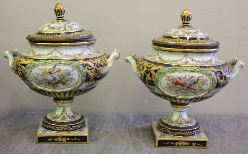 Pair of Sevres Porcelain and Lidded Urns.