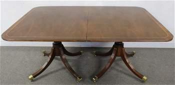 Baker Signed Mahogany Banded Dining Table.
