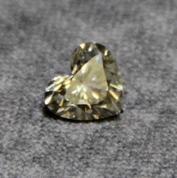 JEWELRY. Fancy Yellow Heart Shaped Diamond.