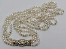 JEWELRY. 18kt and Triple Strand Pearl Necklace.
