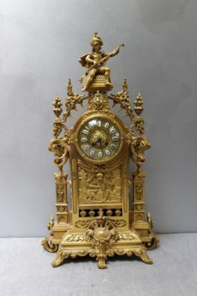 French Dore Bronze Cathedral Style Figural Clock.