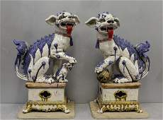 Pair Of Large Glazed Pottery Foo Dogs