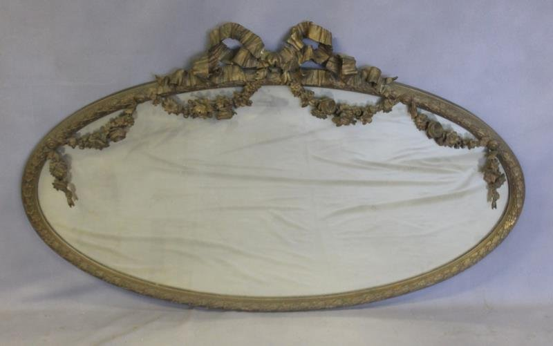Antique Giltwood and Gessoed Oval Ribbon Mirror.
