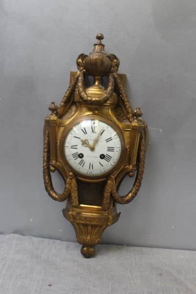 Quality Bronze Cartel Clock With Enamel Face.
