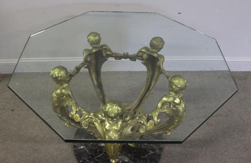 Bronze And Glass Top Figural Coffee Table