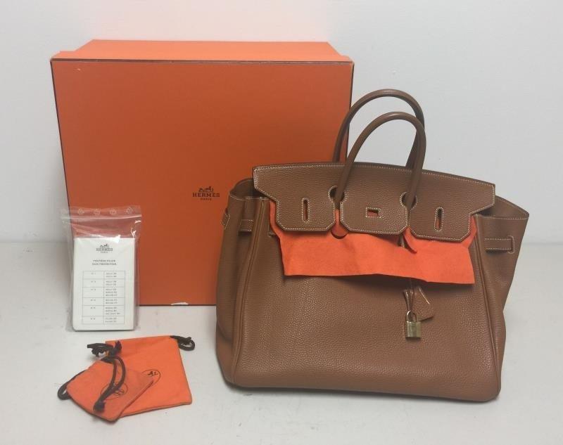 HERMES Gold Taurillon 35cm Birkin Bag.