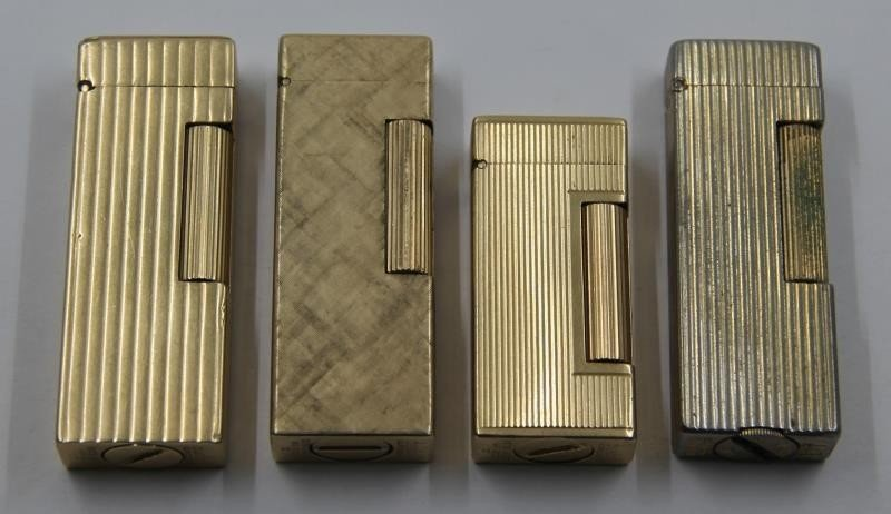 GOLD. Collection of 3 14kt Gold Dunhill Lighters.