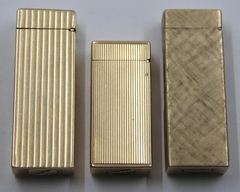 GOLD. Collection of 3 14kt Gold Dunhill Lighters. - 7