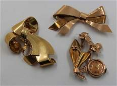 JEWELRY. Retro Gold Bow Form Brooch Grouping.