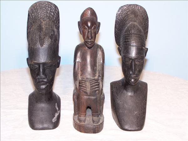 13: A collection of Ebony African statues, heights vary