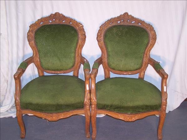 24B: Pair of Spanish arm chairs, highly carved w/ flora