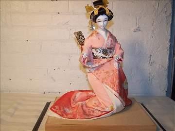 189B: Japanese Geisha doll w/ peach dress in box, 12 1/