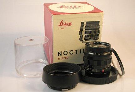 275: 50mm Noctilux f1,2 Nr. 2254701 with lens hood [Ex+