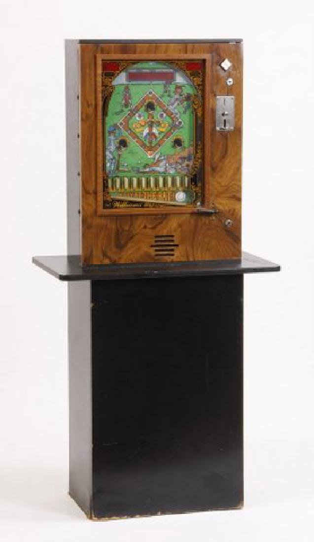 Electronic coin operated pinball machine