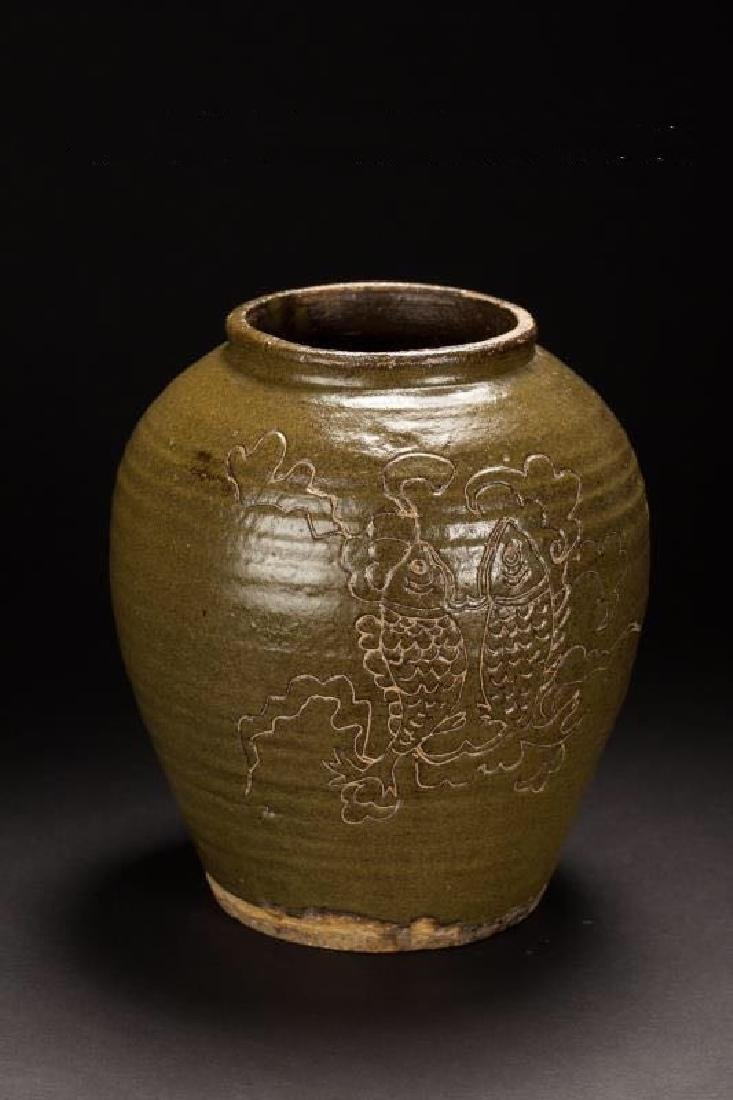 A CIZHOU TEA DUST GLAZED FISH JAR JIN DYNASTY(907-1125)