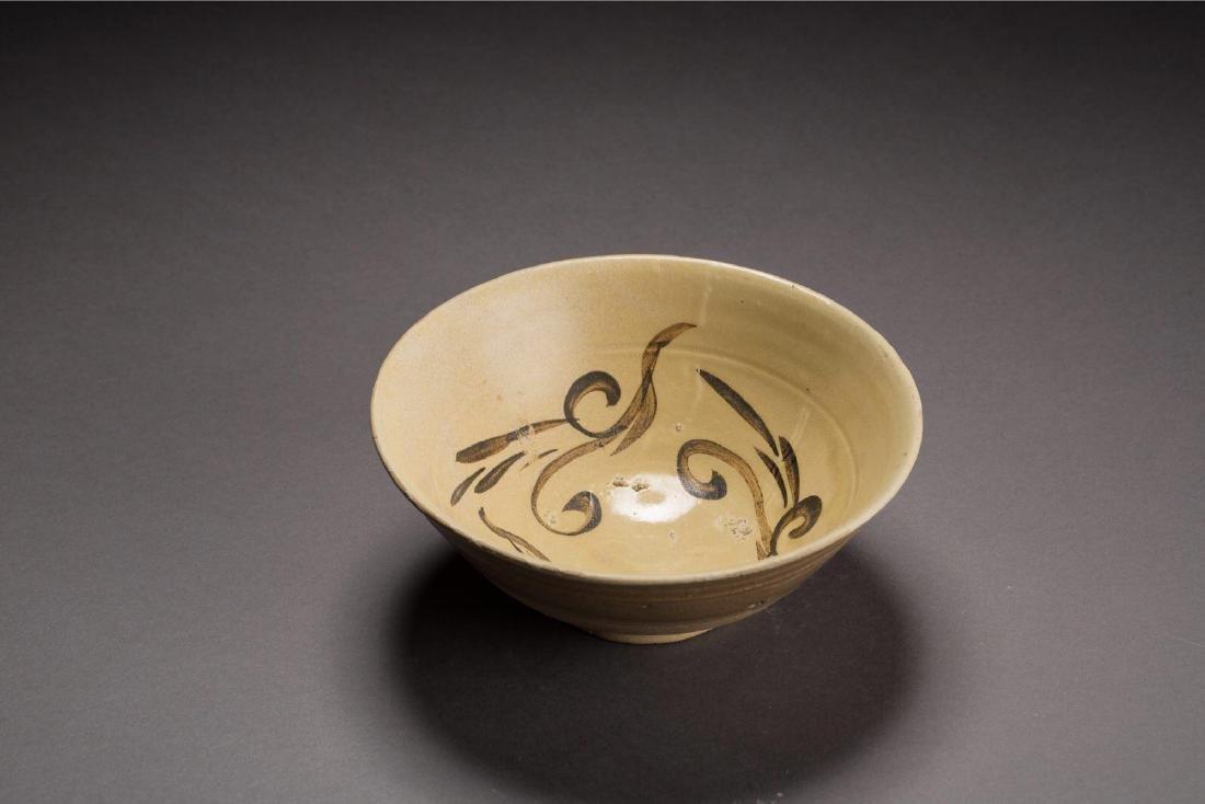 A DRAGON PATTERN BOWL CIZHOU YAO JIN DYNASTY(907-1125)