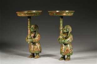 A pair of figure bronze lamp base of Western Zhou