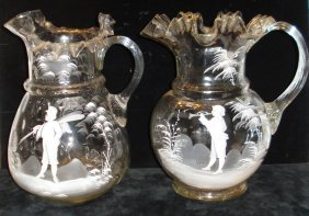 Two clear blown Mary Gregory style glass water pitchers