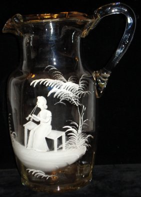 Tall clear blown Mary Gregory style glass water pitcher