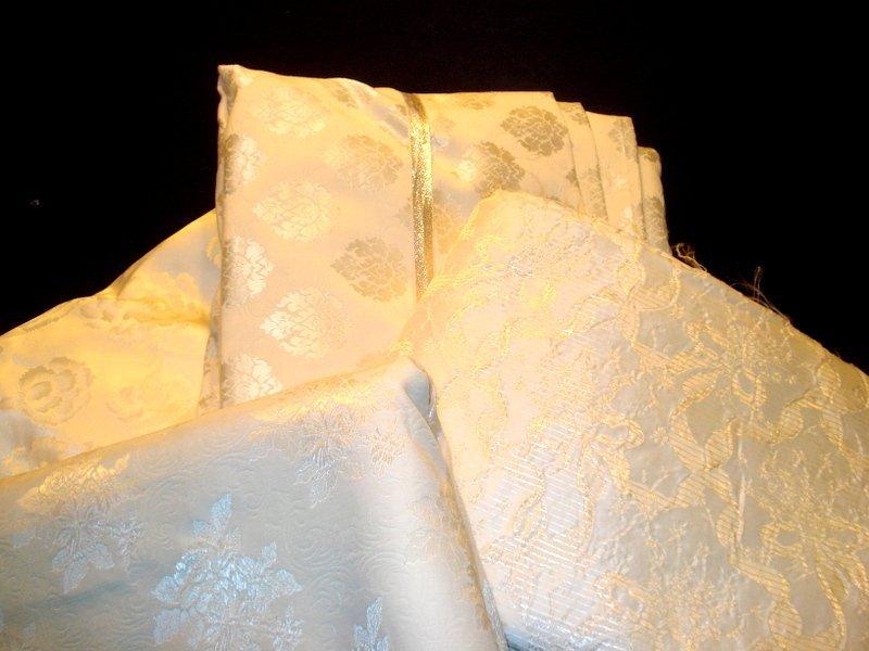 Grouping of white linen, satin, & Taffeta.
