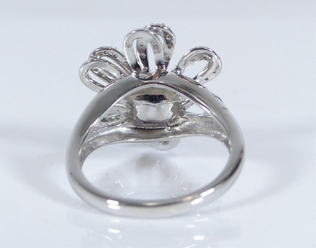 14kt WHITE GOLD TANZANITE & DIAMOND FLOWER RING - 7