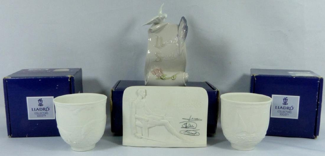 4pc LLADRO PORCELAIN CANDLE HOLDERS & PLAQUES
