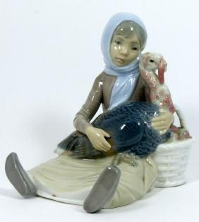 LLADRO 'GIRL WITH TURKEY' PORCELAIN FIGURINE 4569