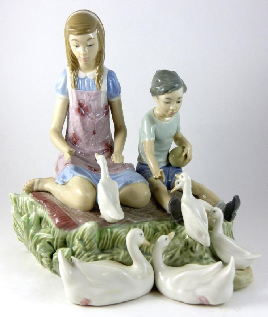 LLADRO 'PLAYING WITH DUCKS' PORCELAIN FIGURINE