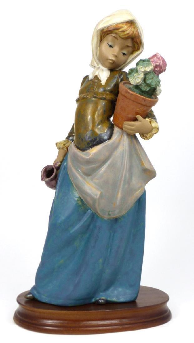 LLADRO 'GIRL WITH GERANIUM' PORCELAIN FIGURINE