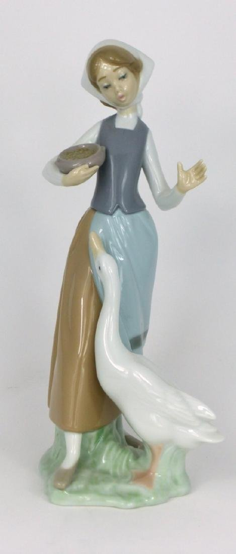 LLADRO 'GIRL WITH DUCK' PORCELAIN FIGURINE