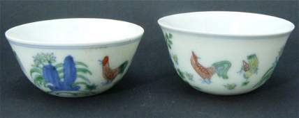 TWO QING DYNASTY DOUCAI PORCELAIN WINE CUPS