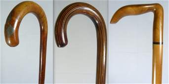 THREE WOOD CARVED CANESWALKING STICKS GROUP