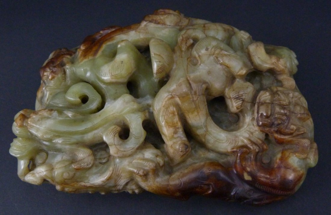 CHINESE WHITE & RUSSET JADE CARVIING OF FOO LIONS