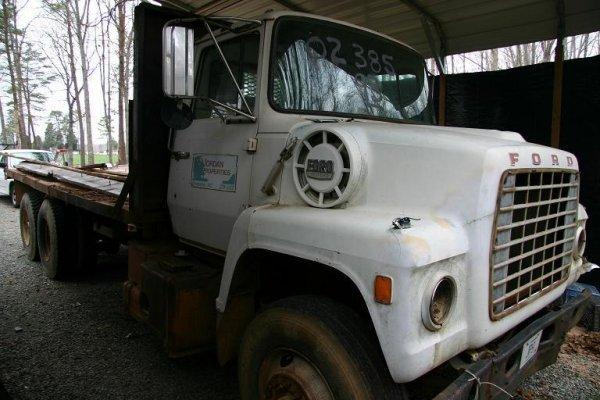 12: FORD DUMP TRUCK LN 9000