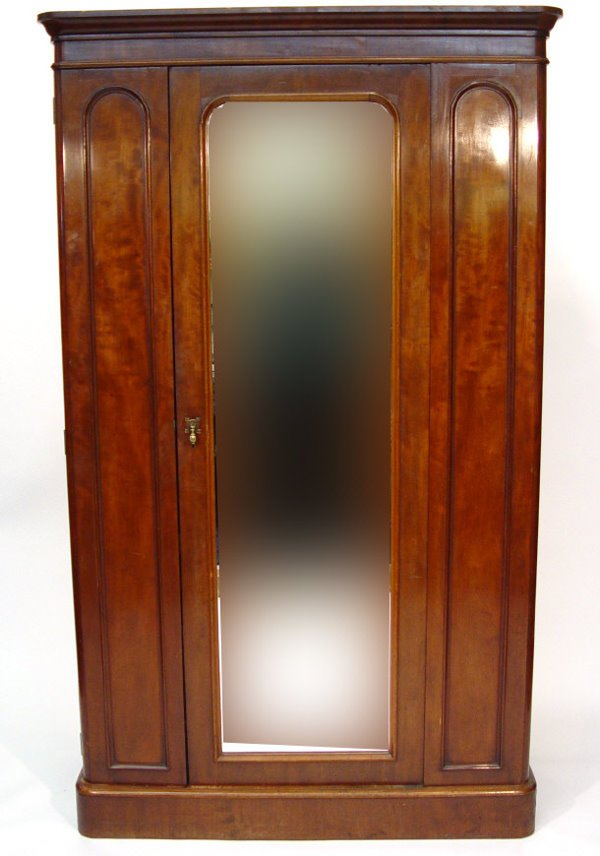8: Victorian mahogany compactum wardrobe, fitted with a