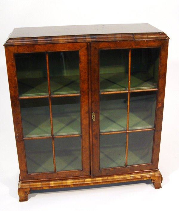 21: 19th Century cross-banded walnut bookcase with two