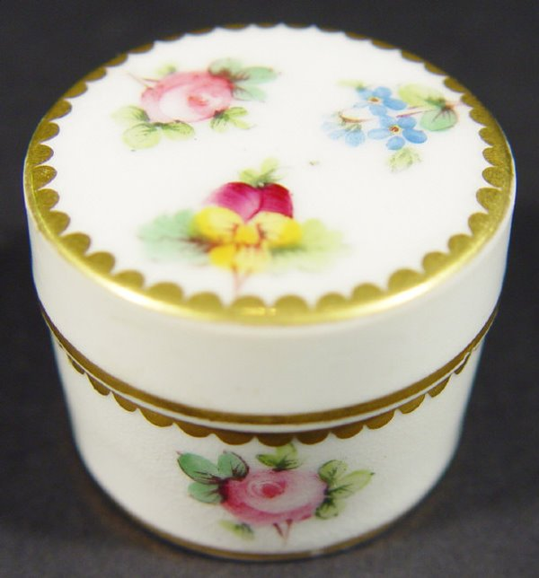 563: Minton china pill box and cover, handpainted with