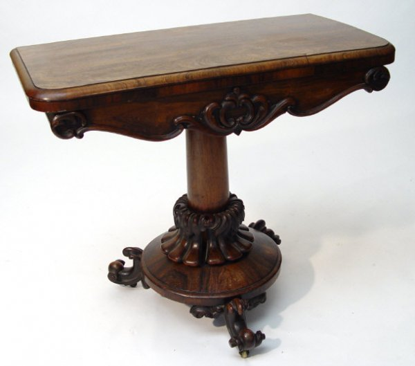 5: Victorian rosewood swivel topped card table, the hin