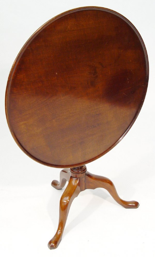 16: Victorian circular mahogany snap top table supporte