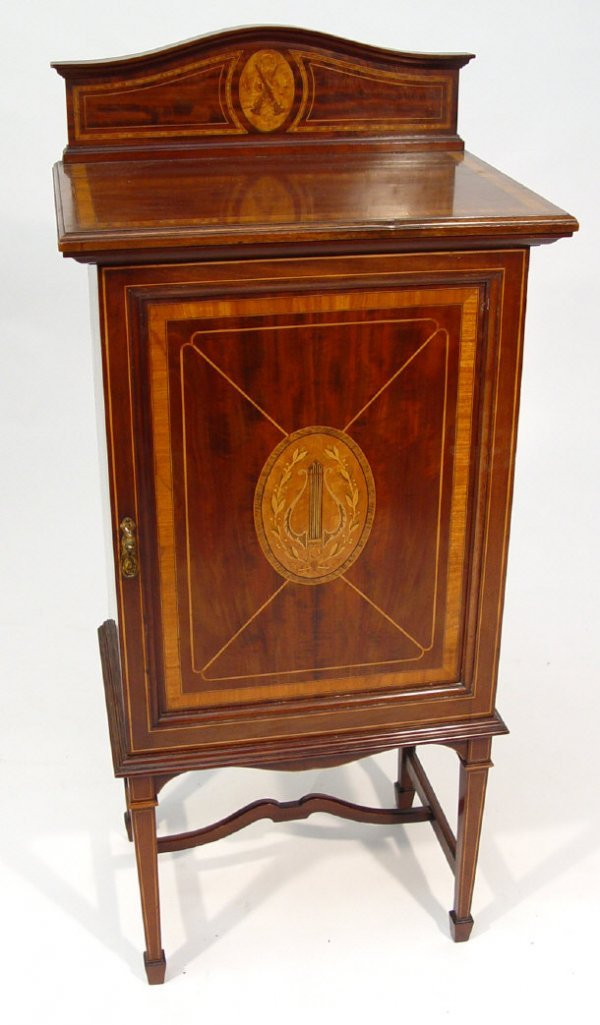 23: Edwardian mahogany music cabinet, the pediment and