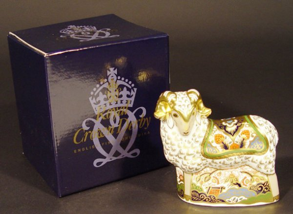 1103: Boxed Royal Crown Derby ram paperweight, exclusiv