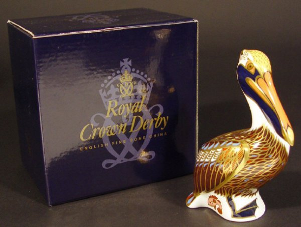 1107: Boxed Royal Crown Derby brown pelican paperweight