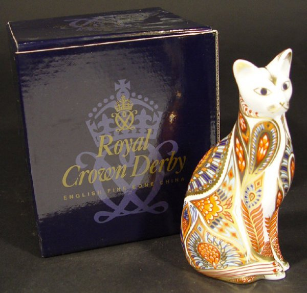 1110: Boxed Royal Crown Derby Siamese cat paperweight,
