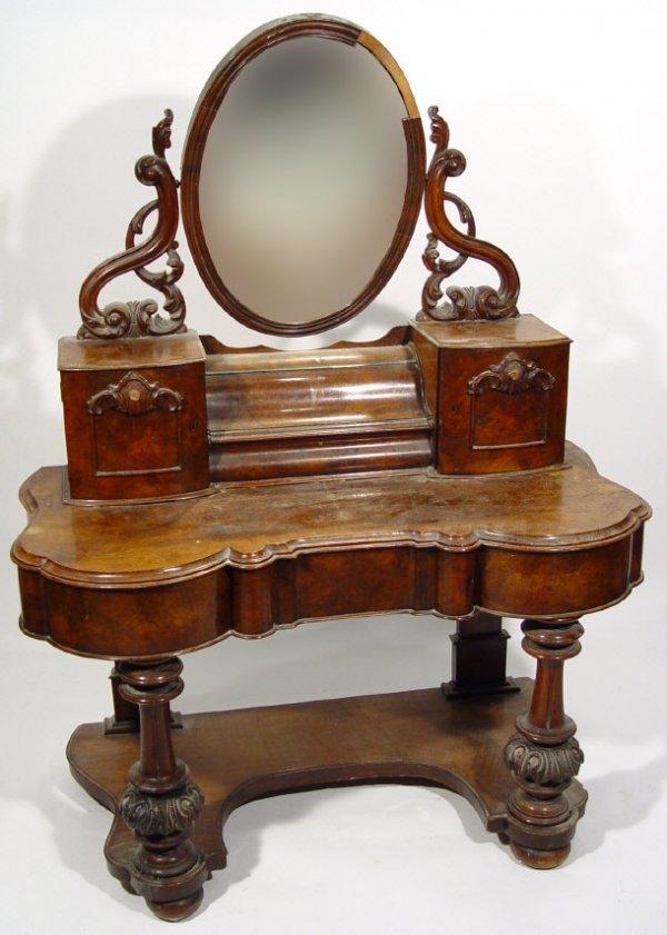 14: Victorian walnut mirror backed duchess dressing tab